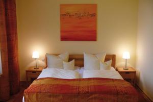Ein Bett oder Betten in einem Zimmer der Unterkunft Villa Am Park