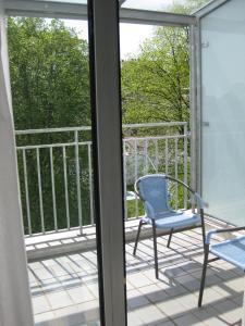 Balkón nebo terasa v ubytování Dom Hotel
