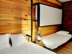 Cama o camas de una habitación en Hostal Erasmus by gaiarooms