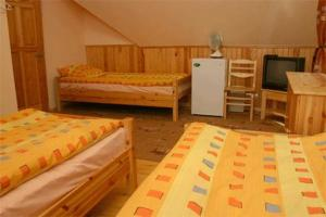 A bed or beds in a room at Melnais Starkis