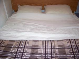A bed or beds in a room at Holiday Cottage