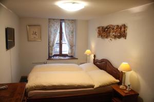 Un ou plusieurs lits dans un hébergement de l'établissement Auberge Communale Bogis Bossey