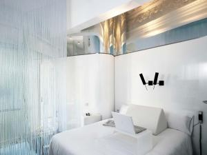 A bed or beds in a room at Chic & Basic Born Boutique Hotel