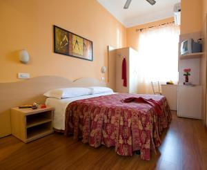A bed or beds in a room at Hotel Sabatino Milan