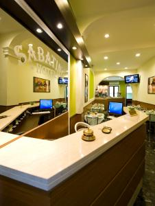 A kitchen or kitchenette at Hotel Sabatino Milan