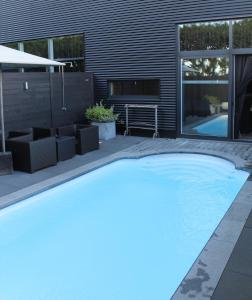 The swimming pool at or near Pure Hotel