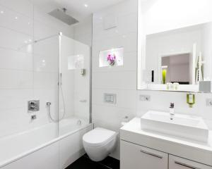 Ein Badezimmer in der Unterkunft Central Hotel