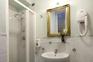 Ванная комната в Hotel Montreal