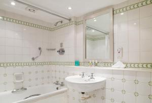A bathroom at Mercure Banbury Whately Hall Hotel