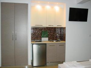 Η κουζίνα ή μικρή κουζίνα στο Harisis Apartments