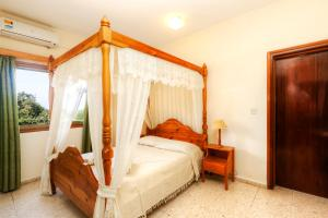 A bed or beds in a room at Follow The Sun Hotel Apartments