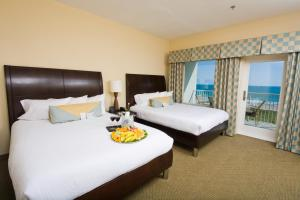 A bed or beds in a room at Hilton Garden Inn South Padre Island