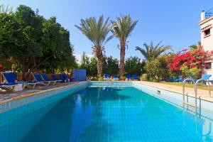 The swimming pool at or close to Follow The Sun Hotel Apartments