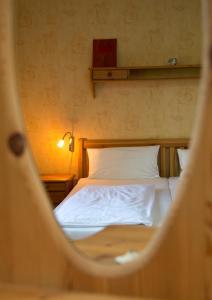 Ein Bett oder Betten in einem Zimmer der Unterkunft Ferienhaus Zur Schmiede