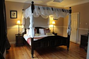 A bed or beds in a room at Adare Country House