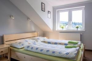 A bed or beds in a room at Pension Rieger