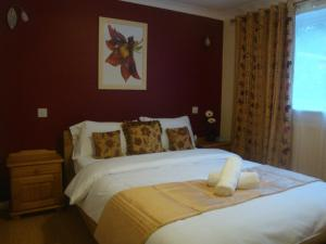 A bed or beds in a room at Remarc Guest House