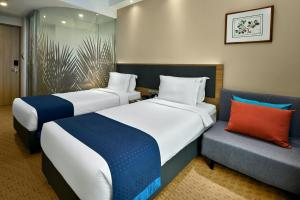 A room at Holiday Inn Express Singapore Orchard Road (SG Clean)