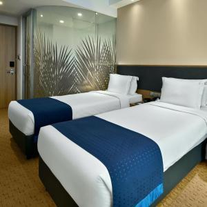 غرفة في Holiday Inn Express Singapore Orchard Road (SG Clean)