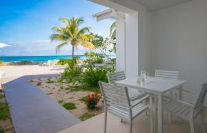A porch or other outdoor area at Le Nautique Beachfront Apartments Mahe