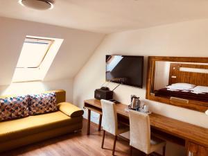 Posezení v ubytování Hotel & Penzión Grand Matej