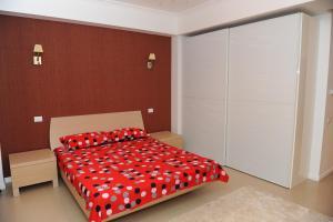 Un pat sau paturi într-o cameră la Apartament Tanya Tudor's Residence