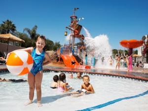 The swimming pool at or near Howard Johnson by Wyndham Anaheim Hotel & Water Playground