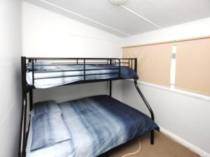 A bunk bed or bunk beds in a room at 59 Wharf Street Opposite Bowling Club