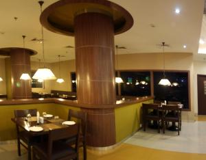 A restaurant or other place to eat at Ginger Hotel Manesar