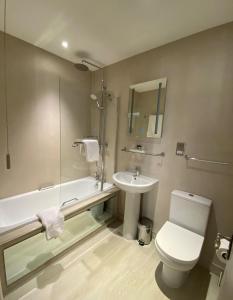 A bathroom at Best Western Ivy Hill Hotel