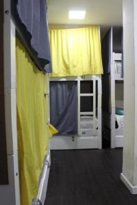 A bunk bed or bunk beds in a room at Farol da Barra Suites e Hostel