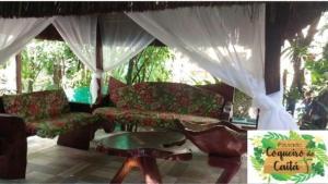 The lounge or bar area at Pousada Coqueiro do Caitá
