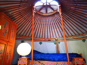 Un ou plusieurs lits dans un hébergement de l'établissement Camping Domaine de Mepillat