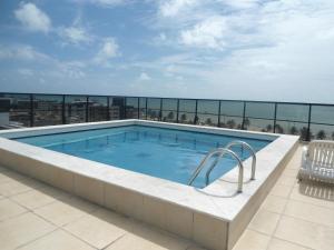 The swimming pool at or near Atlântico Tambaú Home Service