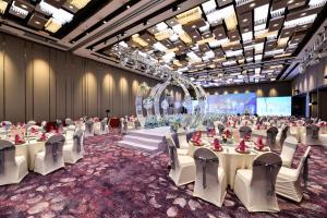 Ein Restaurant oder anderes Speiselokal in der Unterkunft Hotel Equatorial Shanghai