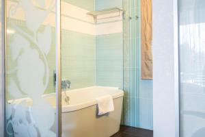 A bathroom at Echo Residence All Suite Hotel