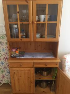 Kuchyň nebo kuchyňský kout v ubytování Apartments Emma