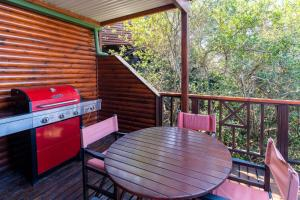 A patio or other outdoor area at Boardwalk Lodge – Self-Catering