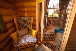 Posezení v ubytování Bosorka Apartments Zrub Mara