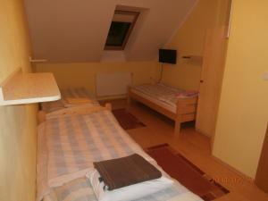 Postel nebo postele na pokoji v ubytování Ubytování v soukromí Olomučany