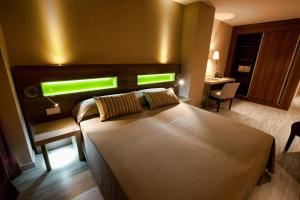 Cama o camas de una habitación en Hotel Allon Mediterrania
