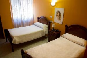 Cama o camas de una habitación en Hostal Algodon
