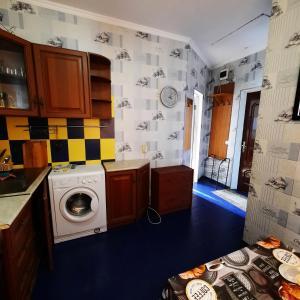 A kitchen or kitchenette at Гостевой дом на 4 номера