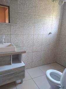 A bathroom at Pousada villani