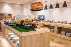 A cozinha ou kitchenette de Unipark by Oro Verde Hotels