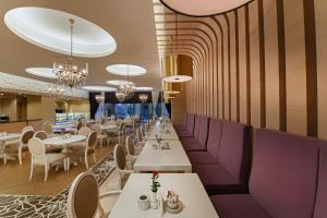 A restaurant or other place to eat at Sirene Belek Hotel
