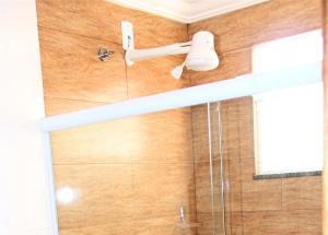 Um banheiro em Hotel Santo Afonso