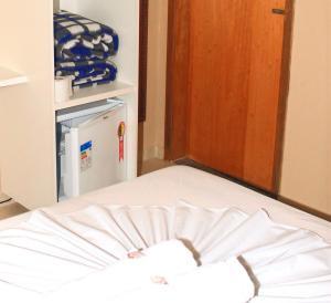 Cama ou camas em um quarto em Hotel Santo Afonso