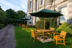 A garden outside Mercure Aberdeen Ardoe House Hotel & Spa