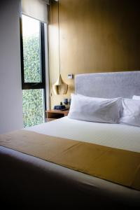 A bed or beds in a room at IT Boutique Hotel & Restaurant